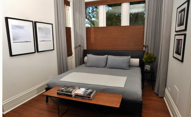 contemporary grey bedroom with top down bottom up woven wood blinds