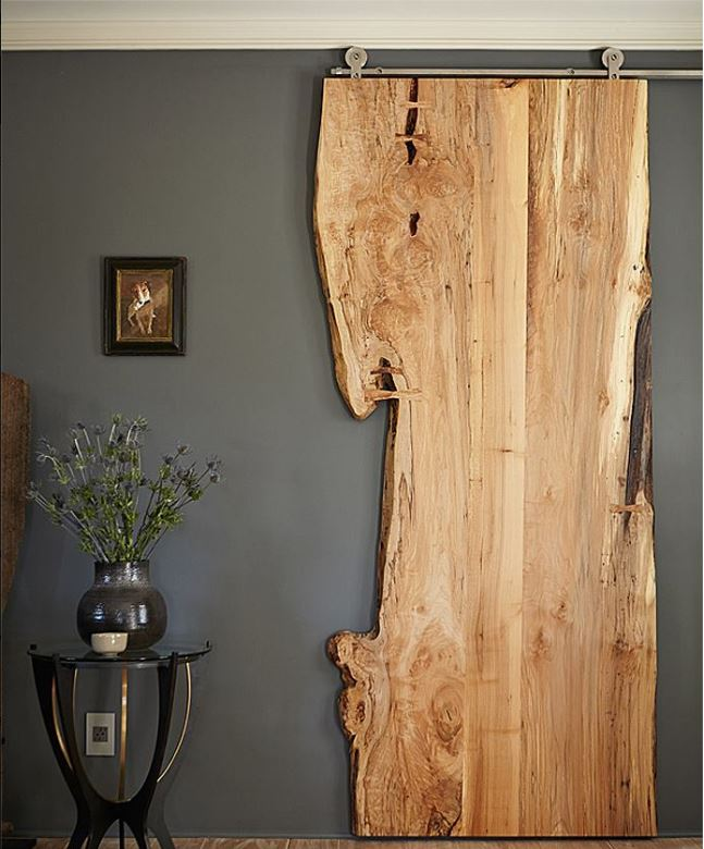 live edge sliding barn door in a transitional decor style living room