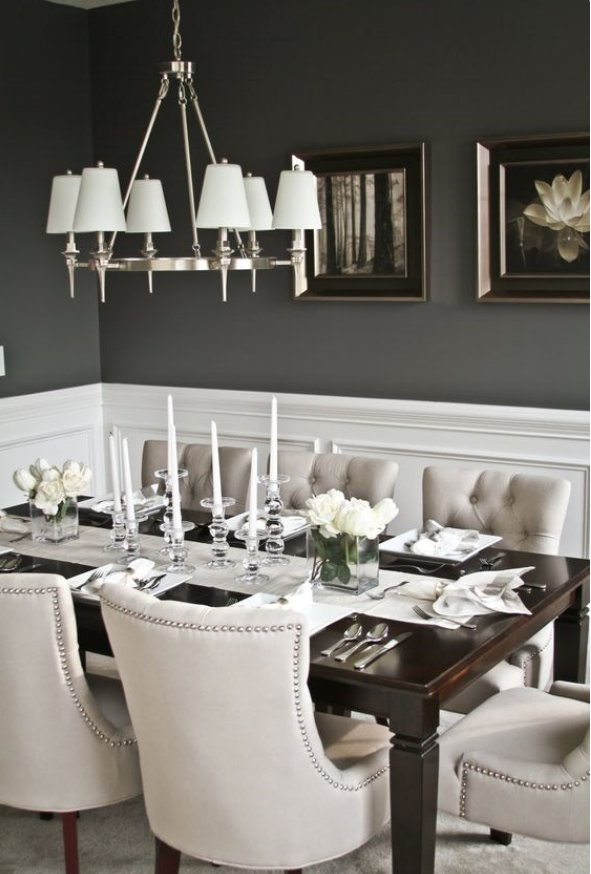 elegant dining room with charcoal wall colour and cream button tufted chairs
